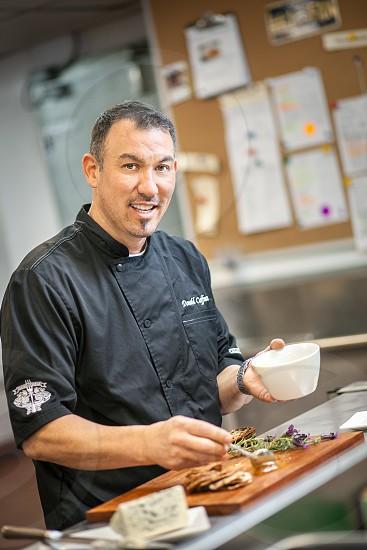 A chef plates a fancy appetizer. photo