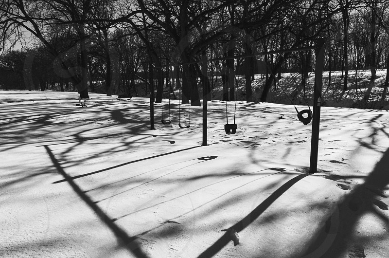 High resolution swing set black and white snow winter park  photo
