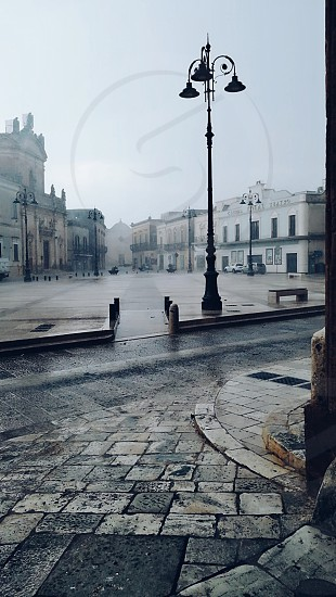 When it is raining the sound of raindrops falling down the streets dominates over the traffic sounds and the darkness suddenly fell down the houses photo
