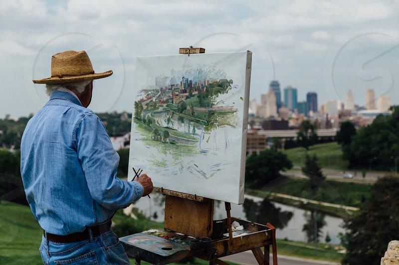 man at canvas painting photo