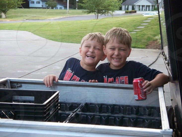 twin boys having fun together happiness identical smiling best buds photo