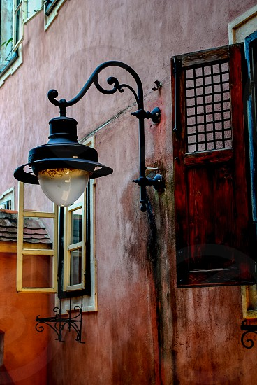 Old street lamp in old house photo