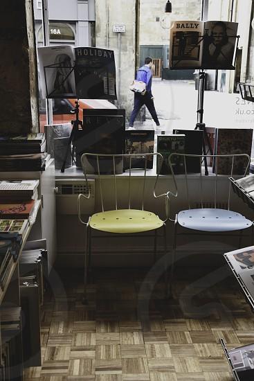 Interior shot of magazine shop. Man walking past window. photo