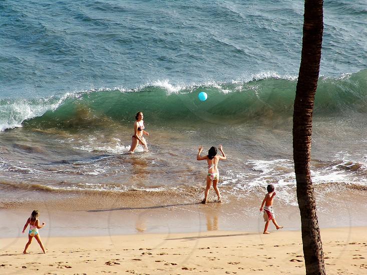 Fun in the waves on Sugar Beach Maui photo