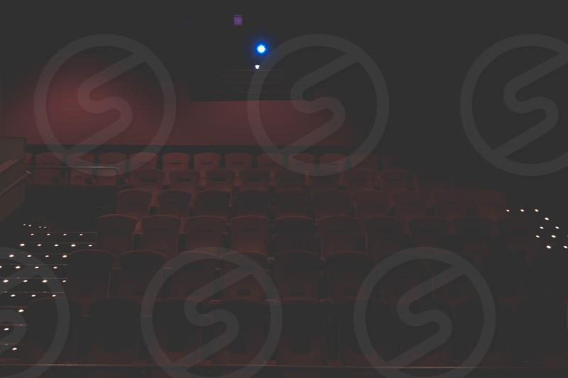 A darkened movie theater photo