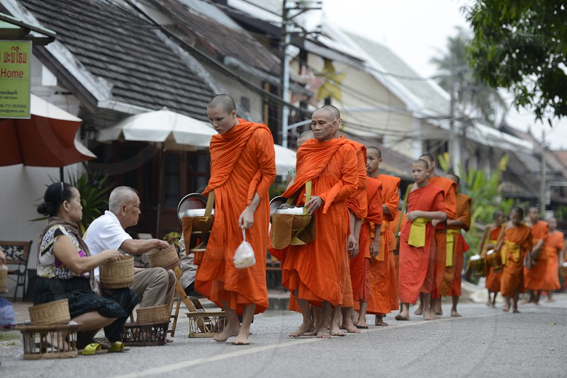 monks in the morning in the town of Luang Prabang in the north of Laos in Southeastasia. photo