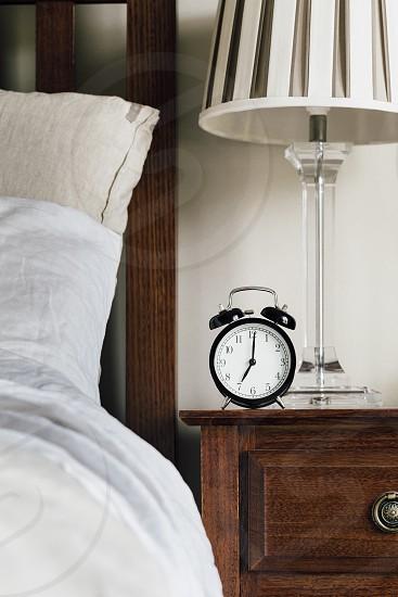 bed clock alarm clock morning wake up 7am time  photo