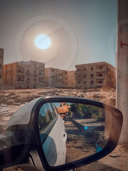 Uber riding somewhere in Cairo Ride ride share Uber Careem taxi in a car driving  side mirror mirror cars car street driver in the middle of nowhere  photo