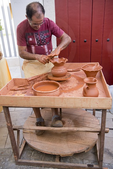 pottery art at the Saturday Market in the town of Loule in the Algarve in the south of Portugal in Europe. photo
