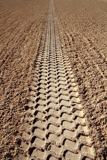 beach sand tyres footprint perspective to infinite Caribbean cleaning tractor photo