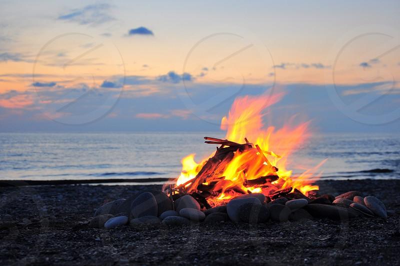 orange bonfire on seashore photo