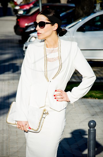 Woman in white business suit on the street photo