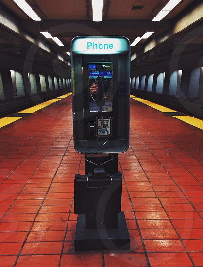 public telephone in train station photo