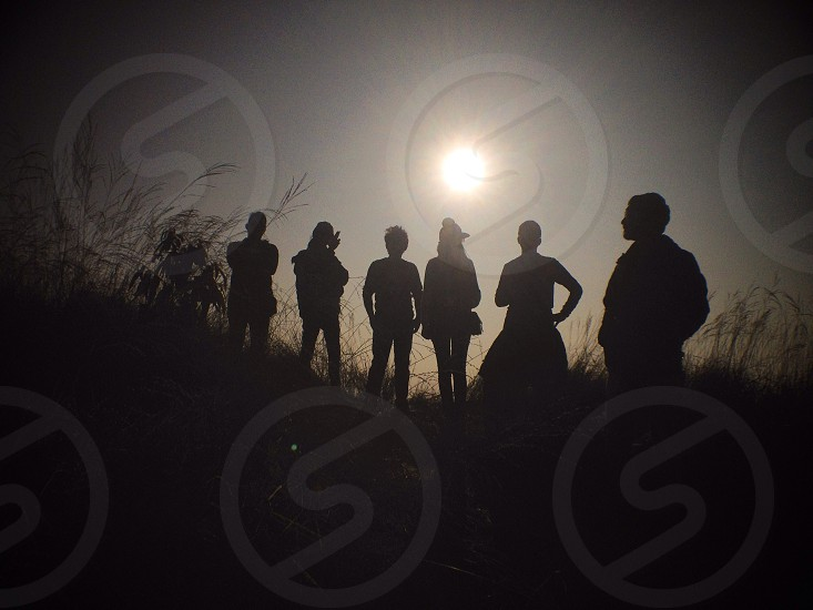 group of people standing silhouette photography photo