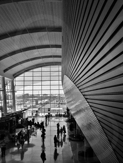 Architecture: Airport terminal arrivals and departures. Black & white version.  photo