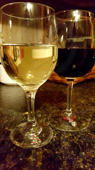 wine for two. red and white wine couple photo