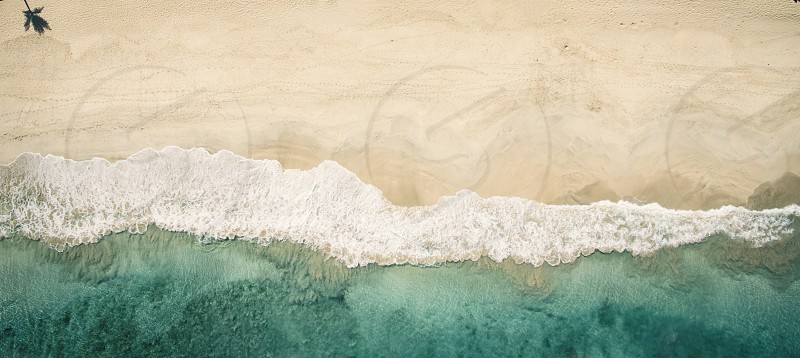 Aerial image of a beach in the Caribbean photo