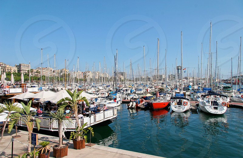 Assortment of Boats and Yachts Moored at the Marina in Barcelona photo