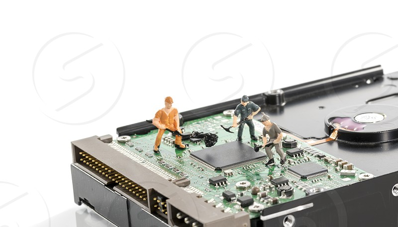puppets busy with hardware computer elements repair or format harddisk photo