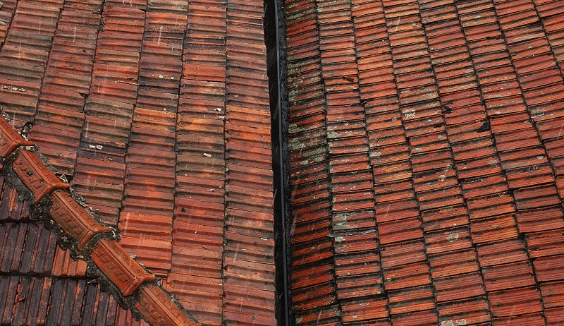 Old roofs during rain abstract composition. photo