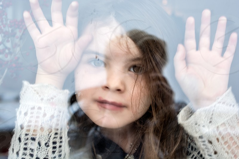 Waiting by the window excited anticipation girl daughter family goodbye mum photo
