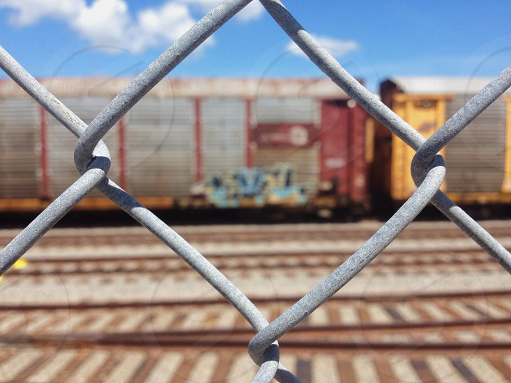 chain metal fence and train photo