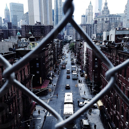 city road from metal fence photo