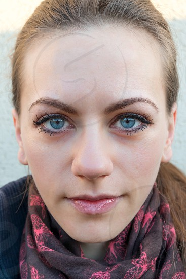 woman face determined knowing confident eyes smile smerk beautiful pretty strong symmetry  photo