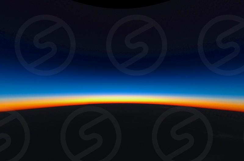 Sunrise over Australia from 39000'. sunrise flying earth space early morning round amazing sight  photo