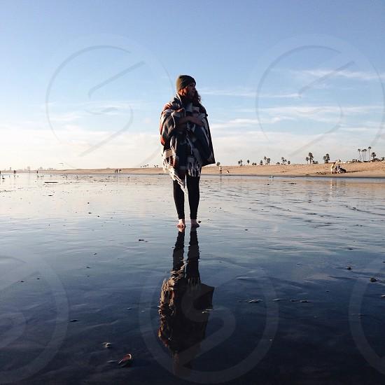 woman walking at the beach photo