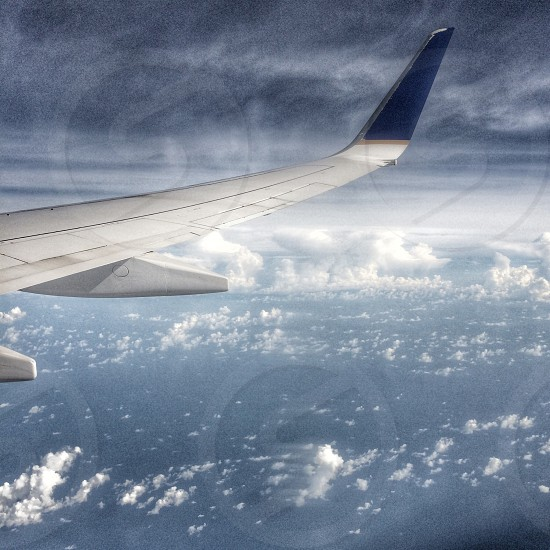 Take off. Flight. Up in the clouds. Wingman. photo
