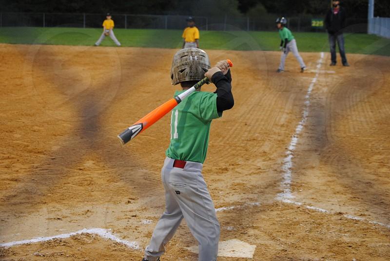 boys playing baseball photo