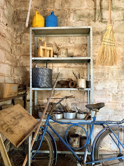 Bike bicycle blue yellow old vintage iron wall outdoors tone palette photo