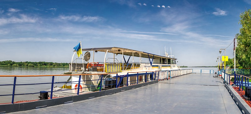 Pleasure boat at the pier in the city of Vilkovo Ukraine on a sunny summer day photo