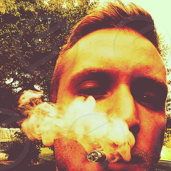 Self portrait. 'WHERE DO THEY GO THESE SMOKE RINGS I BLOW' photo
