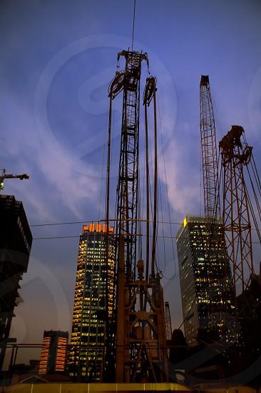 construction cranes on night ove a blue sky photo
