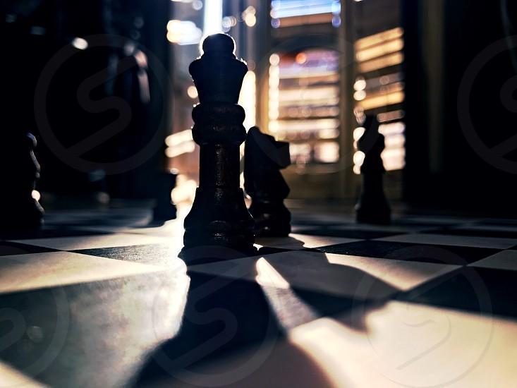 Chess lightshow window game Checkmate Sun Shadows  photo