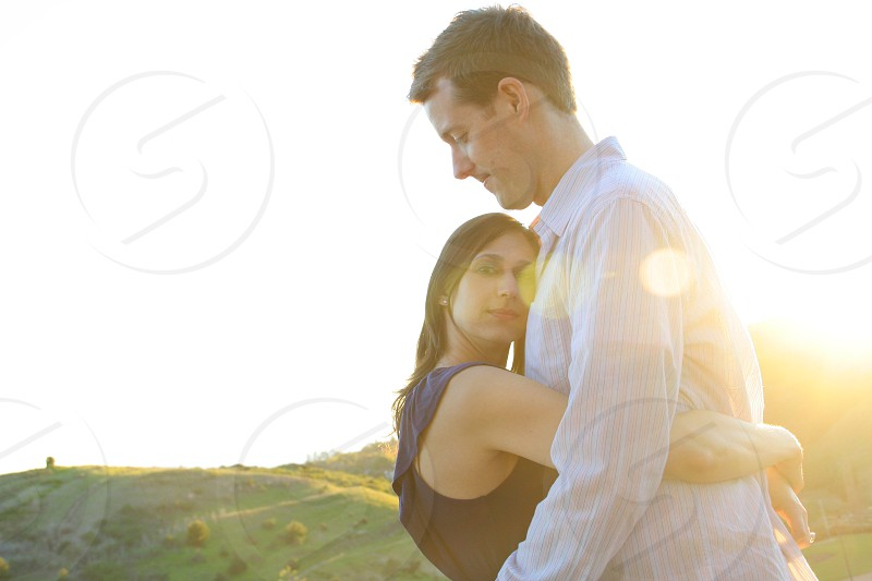 Young couple at sunset. photo