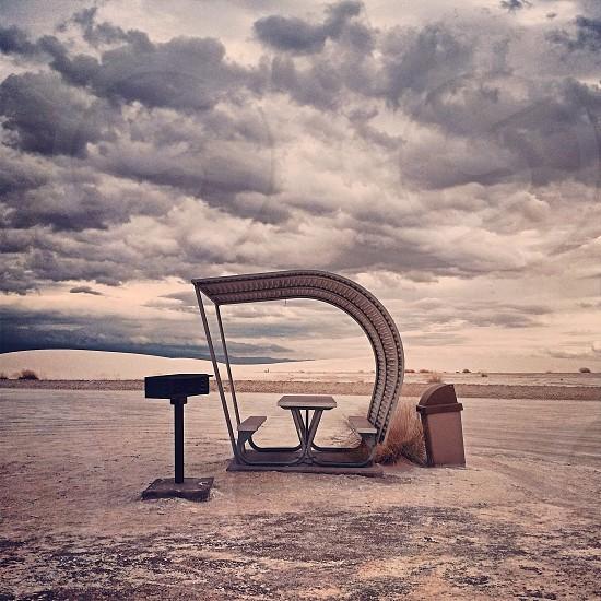 gray bench on dessert  photo