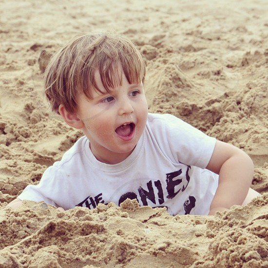 boy playing in sand photo