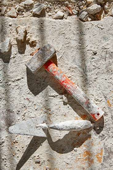 Mason tools on debris background in house improvement construction photo