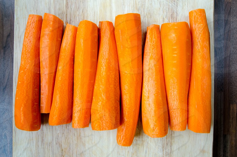Carrots all lined up and ready to chop photo