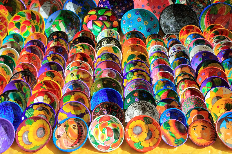 clay ceramic plates from Mexico colorful traditional handcraft photo