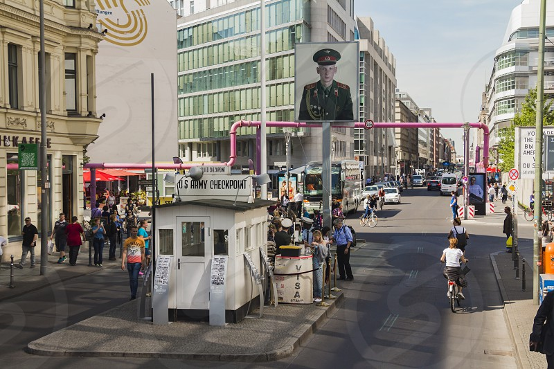 Berlin Germany - May 17 2017: Tourists at Checkpoint Charlie. former Berlin Wall border crossing point between East and West Berlin during the Cold War. photo