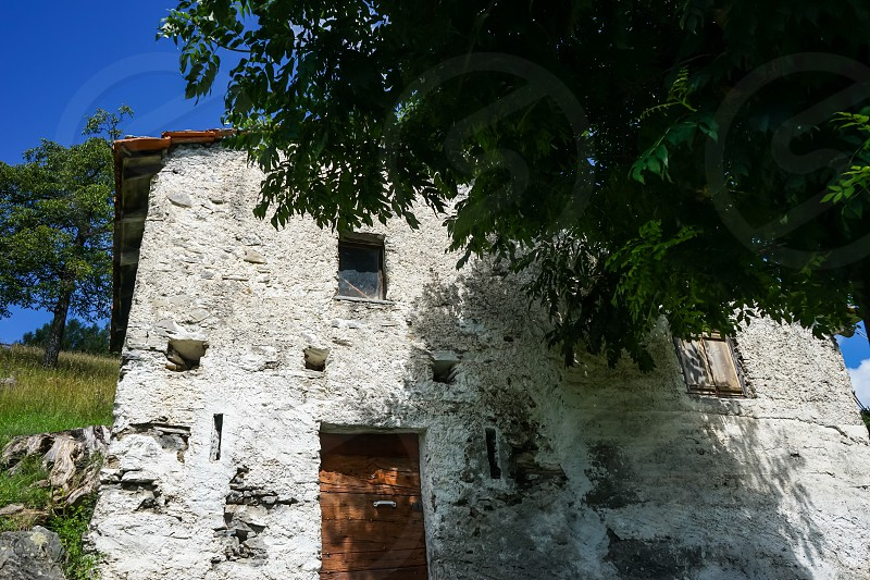 Old whitewashed farmhouse in rural Italy photo