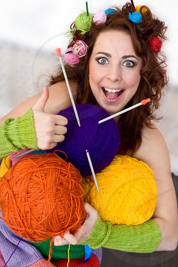 Happy women with bolls of knitting colored thread funny emotions home work photo