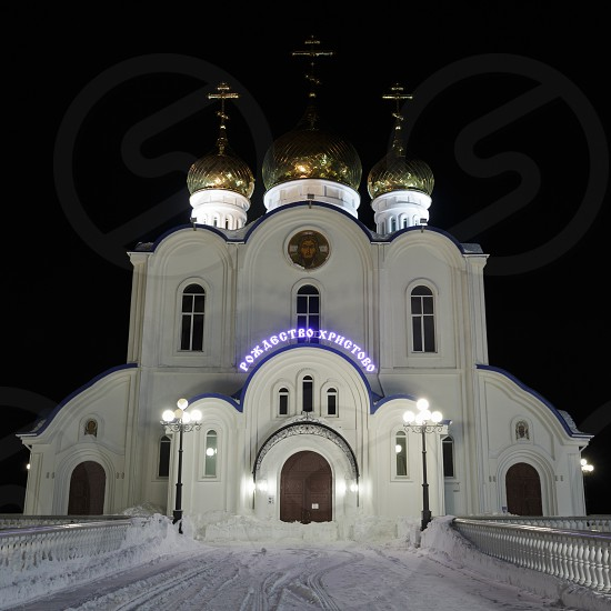 KAMCHATKA PENINSULA RUSSIA - JAN 6 2018: Night illumination of building of Holy Trinity Orthodox Cathedral of Petropavlovsk Kamchatka Diocese of Russian Orthodox Church (Moscow Patriarchate). photo