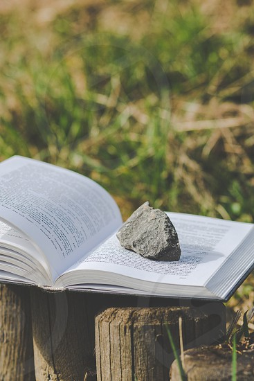 open book with a singlw stone on it photo