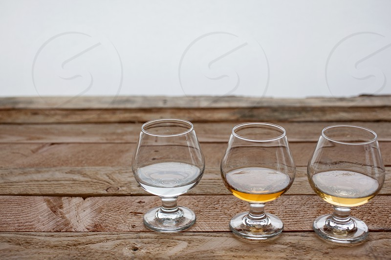 tequila beverage drinks liquor glasses tabletop food photo