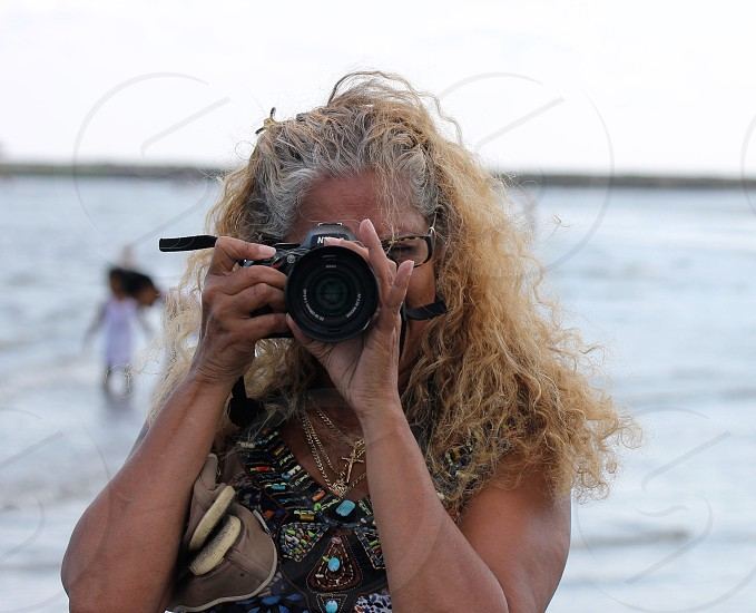 blonde haired woman with black digital camera photo